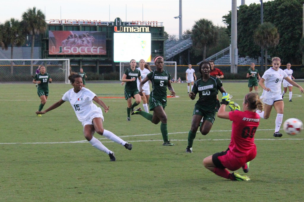 Junior Jasmine Paterson scores a goal during the first half of the soccer game against Stetson College on Friday. The 'Canes won 3-0.Amy Sargeant // Contributing Photographer