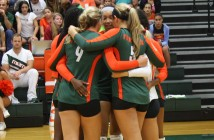 The UM volleyball players huddle up during a break in their game against Missouri held on Saturday at the James L. Knight Sports Complex. Jenny Ulber // Contributing Photographer
