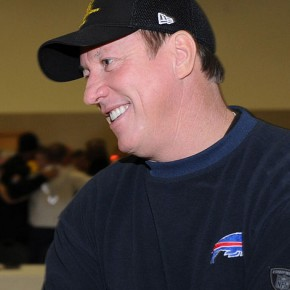 Football hall-of-famer Jim Kelly in December 2010. // Public domain photo by Staff Sgt. Corenthia Fennell