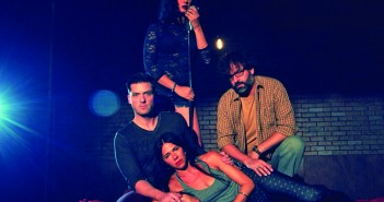 "University of Miami alumna Mariand Torres grasps a microphone, which she uses throughout ""Murder Ballad"" to narrate the story of a love triangle gone wrong. Tom (Chris Crawford), Sara (Blythe Gruda) and Michael (Mark Sanders) share the spotlight in this show as the plot circles around the affair that ends in a murder."
