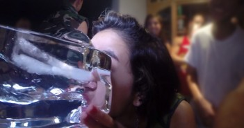 "photo courtesy of vimeo.com An anonymous partygoer drinks from an ice luge during the ""Call of Booty"" party on Sept. 20. A video of the party was released three weeks ago on vimeo.com under the Miami Parties username. It has been played 1,333 times."