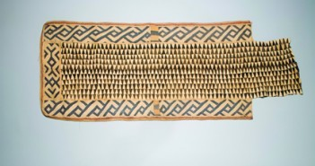 Unknown Kuba Artist(s), Kuba Kingdom, Democratic Republic of the Congo; Woman's Overskirt, mid 20th century; bark cloth, raffia and dye, 38 x 74 in. // Photo courtesy Lowe Art Museum