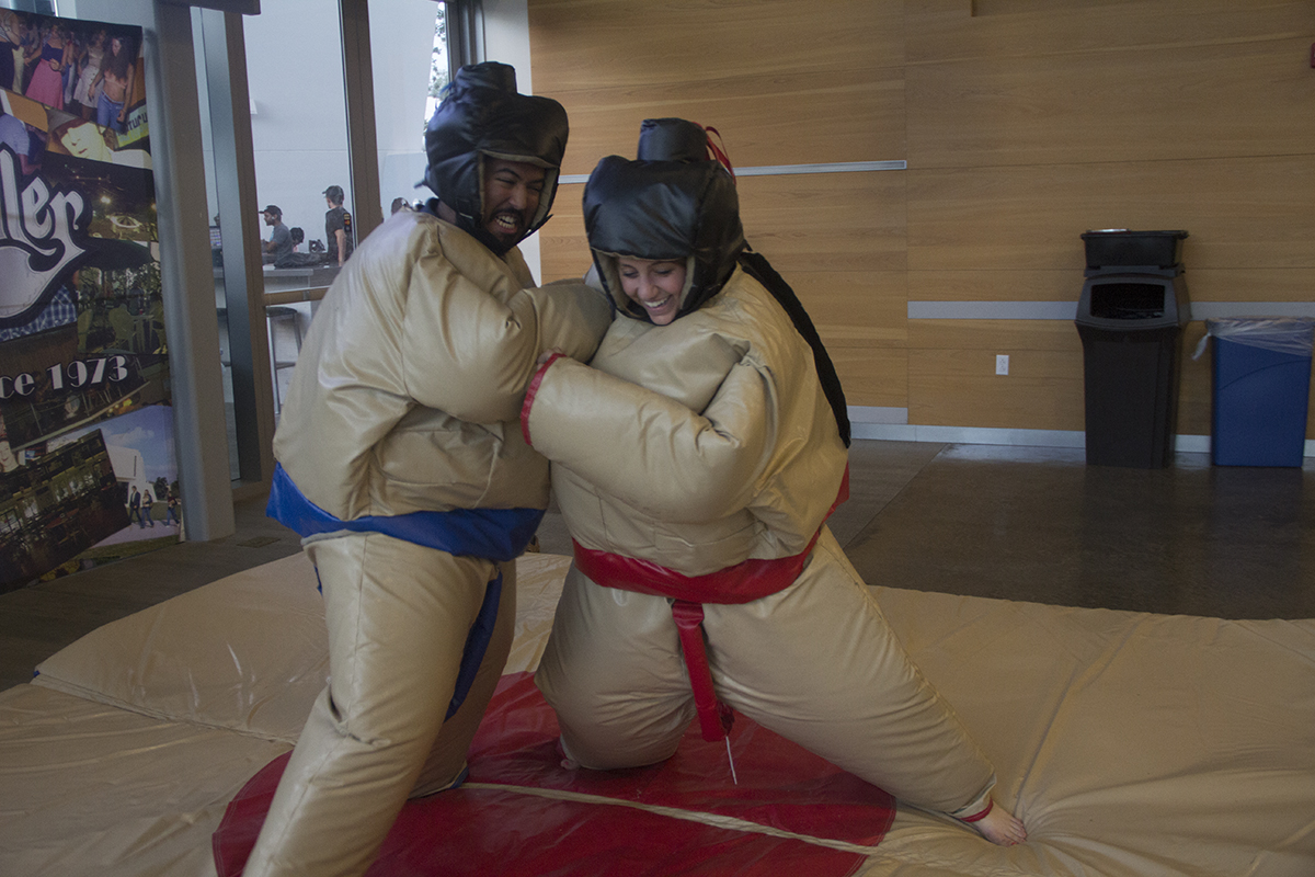 Seniors Julie Earl and Jesus Melendez sumo wrestle during the Hurricane Productions event on Monday evening at the Rat. A food eating contest also took place. Victoria McKaba // Staff Photographer