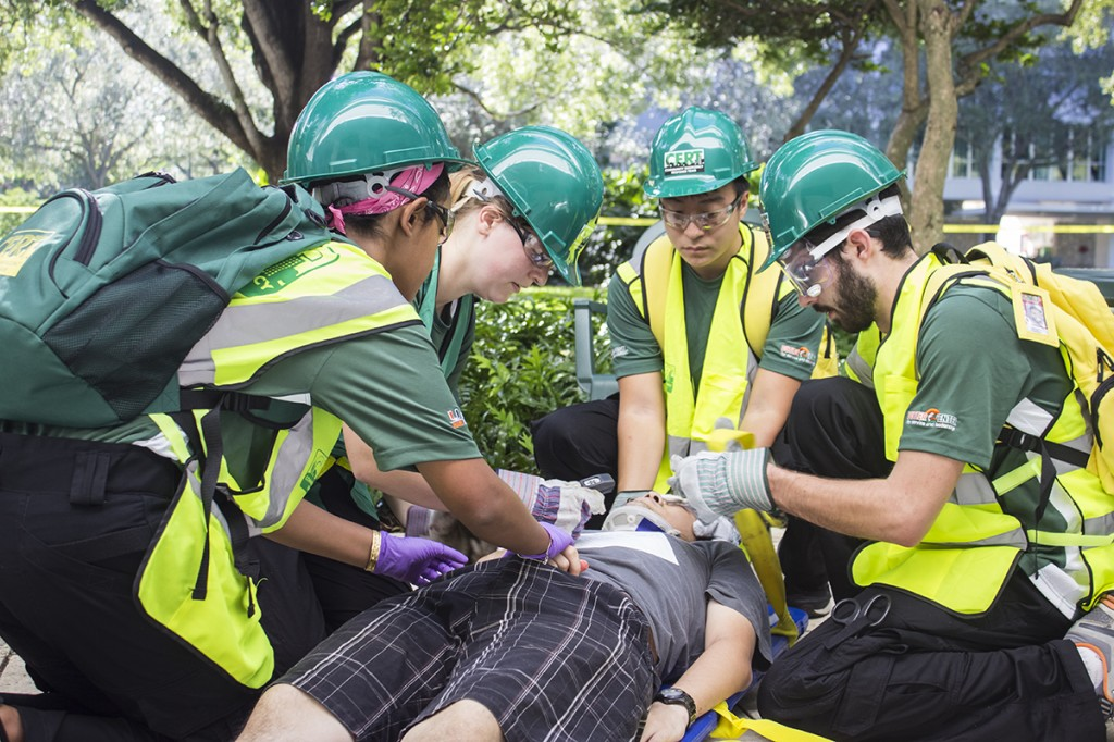 Members of the Canes Emergency Response Team (CERT) attend to a victim during a simulated disaster readiness exercise held on Sunday afternoon outside of the Dooley Memorial building. Giancarlo Falconi // Staff Photographer