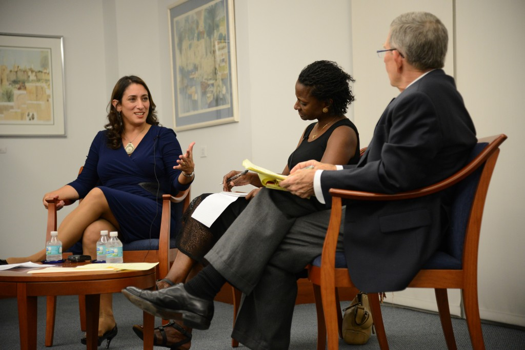 Journalist Ilene Prusher speaks with journalism professors Tsitsi Wakhisi and Joseph Treaster. // Courtesy UM Media