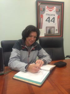 University of Miami women's basketball Coach Katie Meier signs the ODK initiation roll book. // Courtesy UMiami ODK