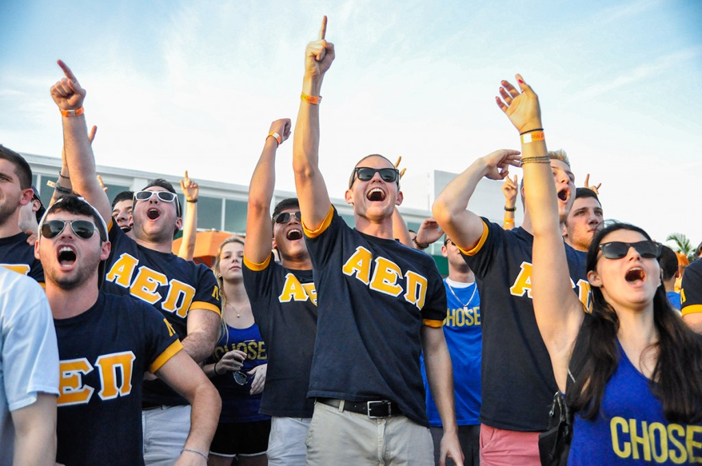 Current members of the Alpha Epsilon Pi Fraternity welcome new members during Bid Day at the Lakeside Patio Stage Friday afternoon. Holly Bensur // Ibis Yearbook