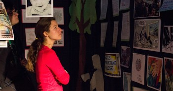 UM alumna Natania Widensky browses the Tunnel of Oppression exhibit, located in the SAC Senate Room, Tuesday afternoon. Giancarlo Falconi // Staff Photographer