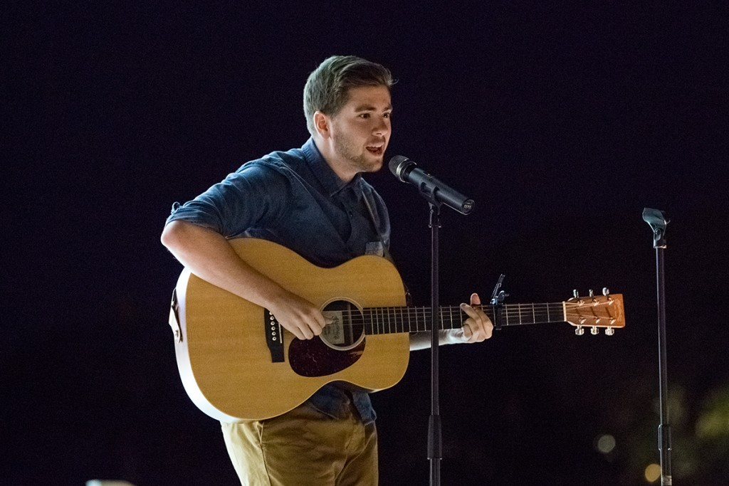 Senior Michael Fenuccio performs during UPride's Open Mic event, conducted as part of Social Justice Week, held on the Lakeside Patio Stage Wednesday night. Nick Gangemi // Photo Editor