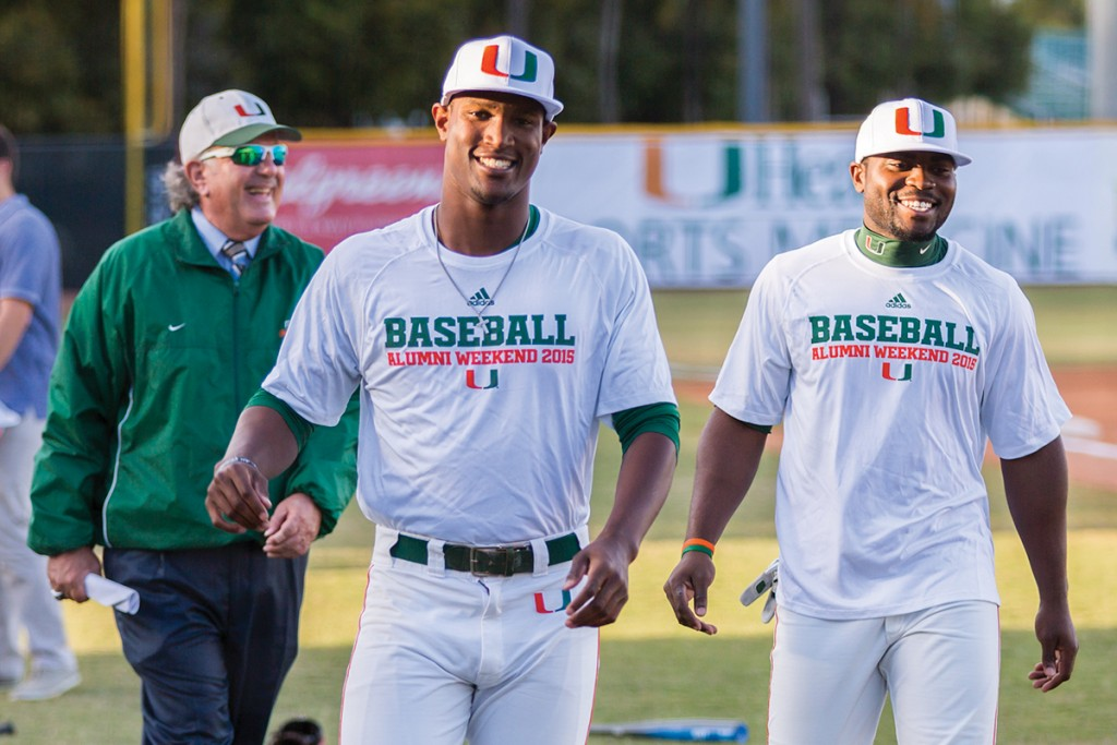 Hurricanes baseball announcer Jay Rokeach, and Alumni Dale Carey and Chantz Mack prepare for Saturday night's Alumni Game held at the Alex Rodriguez Park at Mark Light Field. Nick Gangemi // Photo Editor