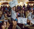 Members of the grey team support their fellow brothers and sisters during the Greek Week God and Goddess Competition held on the Lakeside Patio Stage Wednesday night. Nick Gangemi // Photo Editor