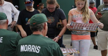 Coach Jim Morris autographs Hurricanes Baseball posters for fans on at the 2014 FanFest. Lyssa Goldberg // Online Editor