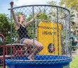 Junior Seanna Sicher, majoring in industrial engineering, celebrates a missed shot during the Engineers' Week dunk tank fundraiser held outside the McArthur Engineering Building Tuesday. Nick Gangemi // Photo Editor