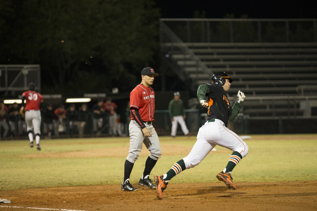 Junior third baseman David Thompson rounds first base in a first inning triple Saturday night at Mark Light Field in the third game versus Rutgers. Canes beat Rutgers 9-3, holding onto their ninth rank in the country. Matthew Trabold // Staff Photographer