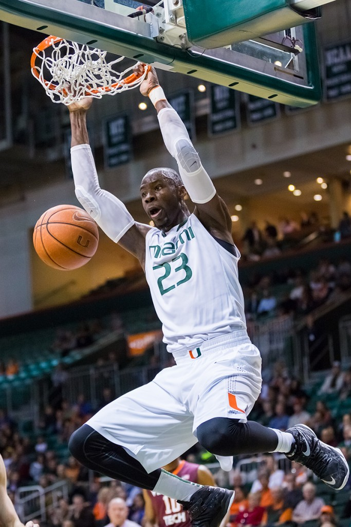 Junior Tonye Jekiri makes a slam dunk during Wednesday night's 76-52 win over Virginia Tech at the BankUnited Center. Nick Gangemi // Photo Editor
