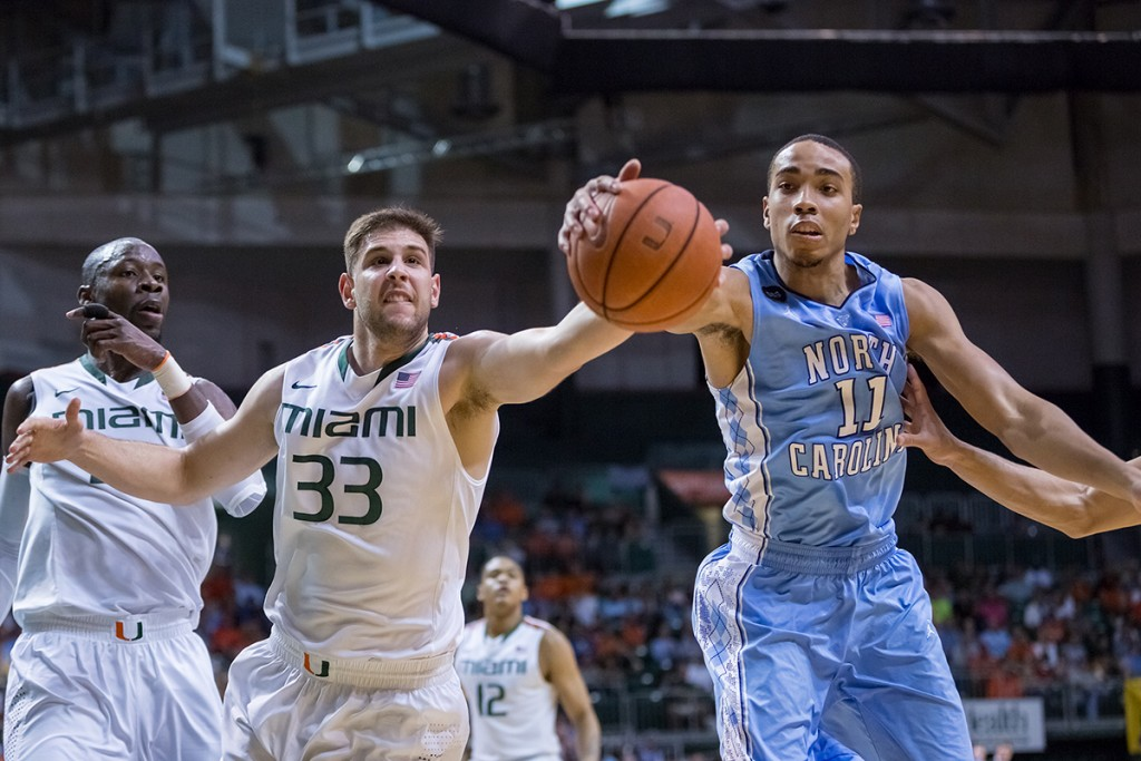 Junior Ivan Cruz Uceda (No. 33) battles North Carolina's Brice Johnson (No. 11) for the recovery of a ball headed out-of-bounds. Nick Gangemi // Photo Editor