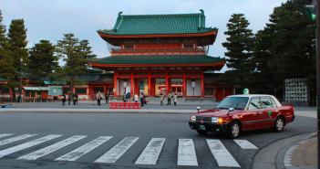 The day starts at the Heian Shrine in Kyoto, Japan. Though a popular tourist destination, many people actively worship and pray here every day. // Jamie Servidio