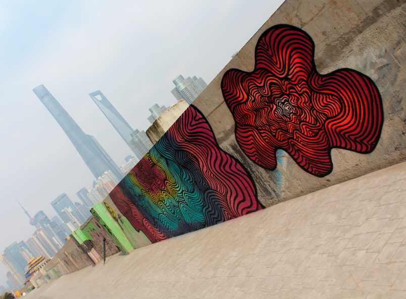 Street art on the Bund in Shanghai brightens up the bleak and polluted skyline in the city of Shanghai. // Jamie Servidio