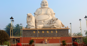 Jamie Servidio poses in front of this giant happy buddha statue on the outskirts of Ho Chi Minh City.