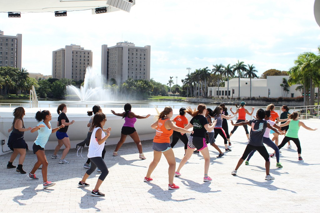Students participate in a free Cfunk class held at the Lakeside Patio Stage Monday afternoon. Giancarlo Falconi // Staff Photographer