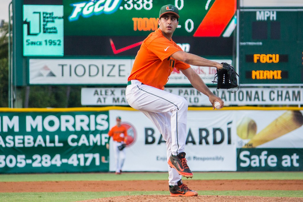 Sophomore Danny Garcia winds up for a pitch during Wednesday night's game against FGCU at Alex Rodriguez Park at Mark Light Field. The No. 13 ranked team lost the game 8-1. Despite the loss, the Canes have performed well thought the season, with an 18-8 record (6-3 ACC). They will move on to play a series against North Carolina this weekend in Chapel Hill.  The Hurricanes men's basketball team threw out the first pitch of the game, promoting its successful NIT run before heading to Madison Square Garden on March 31 for the final four round. Shreya Chidarala // Staff PhotographerThe Hurricanes men's basketball team threw out the first pitch of the game, promoting their successful NIT run before heading to Madison Square Garden on March 31 for the final four round. Shreya Chidarala // Staff Photographer