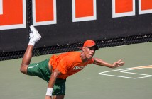 Freshman Nile Clark plays in a doubles competition with Piotr Lomacki (not pictured) during Friday's match against Clemson. The Hurricanes lost 3-4. Shreya Chidarala // Staff Photographer