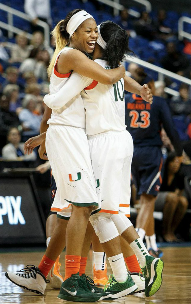 Michelle Woods and Erykah Davenport embrace after a Woods three late in the game. // Courtesy - The ACC