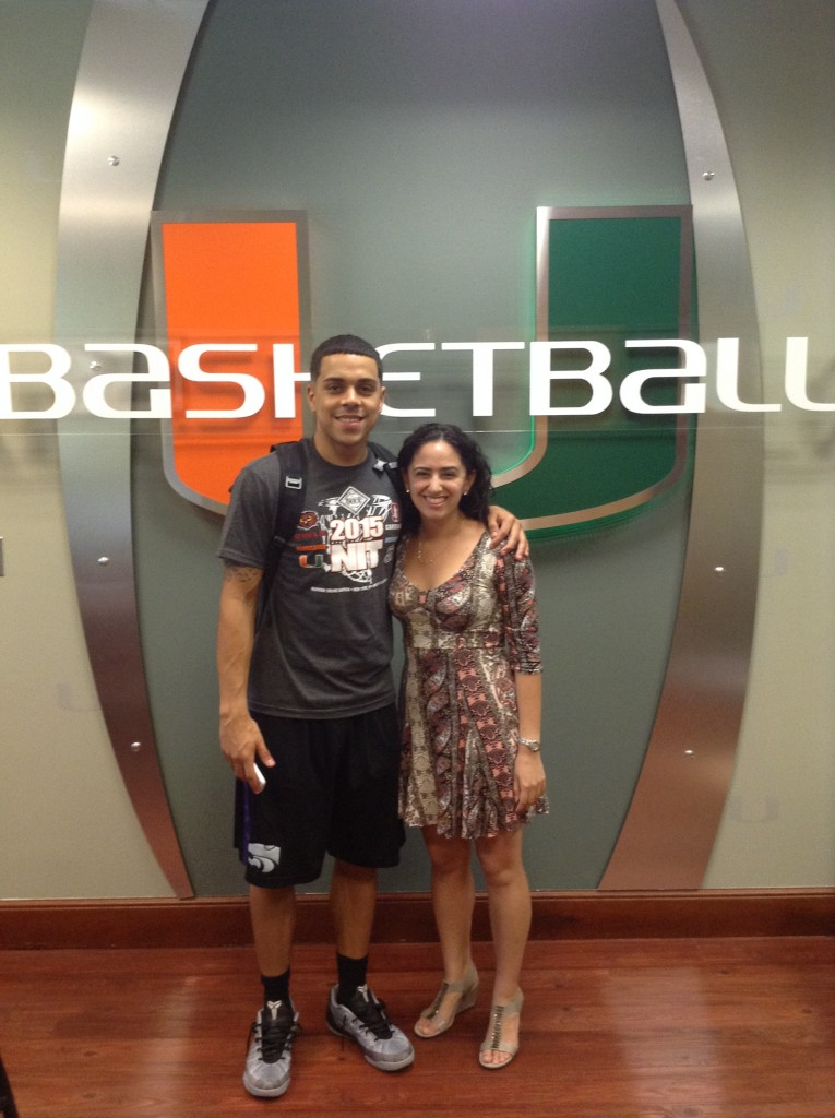 Reporter Elena Tayem with Canes point guard Angel Rodriguez