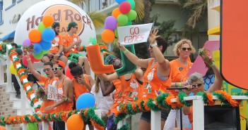"""Members of UM LGBTQ Student Life, UPride, PRISM, OUTLaw and the LGBTQ Faculty and Staff Network represent the University of Miami during the Miami Beach Pride Parade Sunday as they ride down Ocean Drive on a float based on the theme of the animated film """"Up."""" Sebastian the Ibis and the Hurricanettes joined the rest of the group to celebrate diversity and pride. Lyssa Goldberg // Online Editor"""