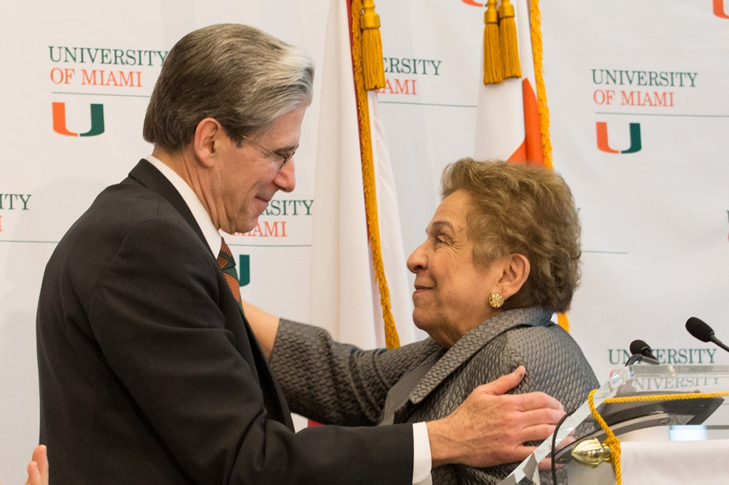 Sixth president Dr. Julio Frenk and current UM President Donna E. Shalala embrace each other at a press conference Monday. Erika Glass // Managing New Editor