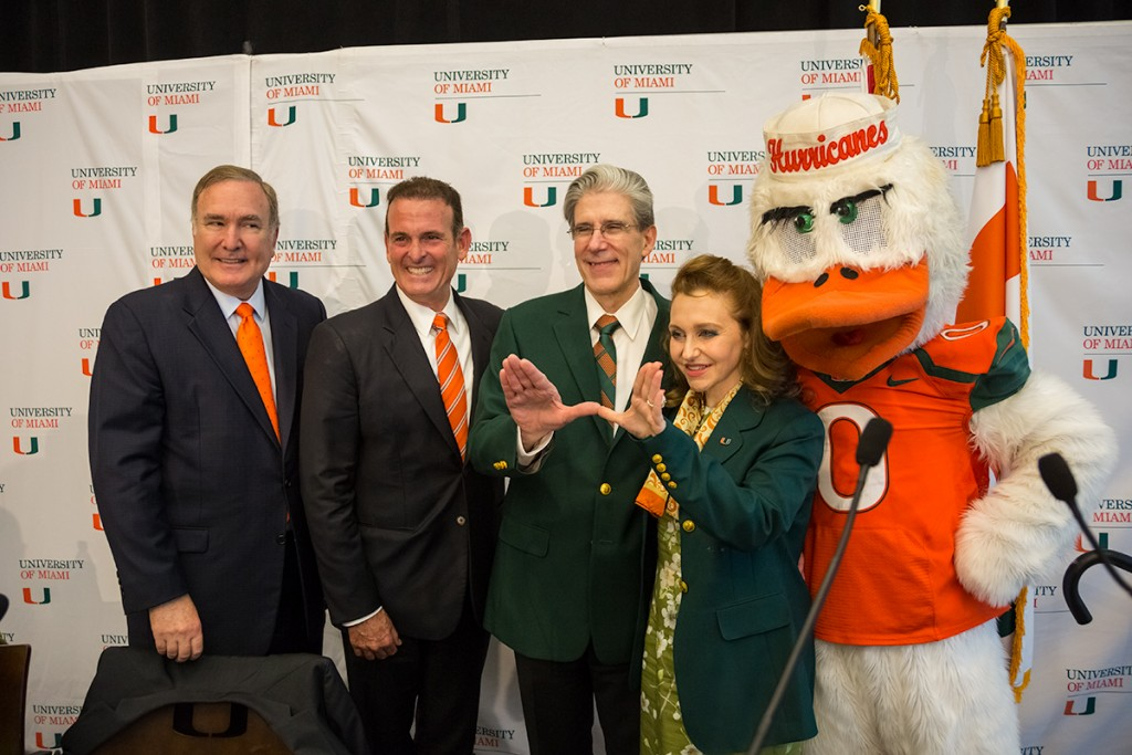 """University of Miami President Elect Dr. Julio Frenk throws up the """"U"""" along with his wife, Felicia Knaul after a press conference where the UM Presidential Search Committee announced their decision. UM Board of Trustees Vice Chair Richard Fain and Chair Stuart Miller also attended Monday's event held at the SAC. Nick Gangemi // Photo Editor"""