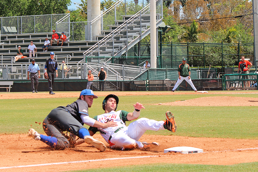 Garrett Kennedy (No. 40) slides into third base in the bottom of the third inning in the last game of the series against Duke. The Canes beat the Blue Devils 10-0 and swept the series Sunday. Hallee Meltzer // Assistant Photo Editor