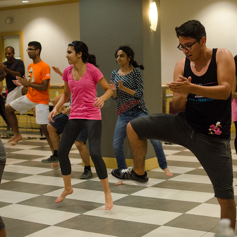 University of Miami's Bhangra dance team holds a practice in the University Center Storm Surge room Tuesday evening to teach students classic Bhangra steps as part of a workshop to help dancers before team auditions. Alisha Kabir // Contributing Photographer