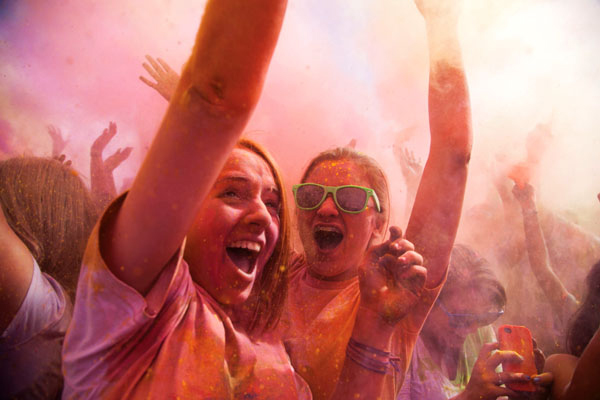 "During the ""Color Me Rad"" 5k at Sun Life Stadium, runners have color powder tossed on them. After crossing the finish line, the participants gathered to listen to music, get free merchandise, and toss more color on each other. File Photo"