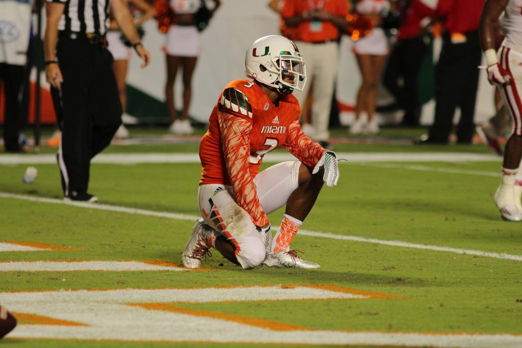 Tracy Howard (3) takes a knee after seeing Nebraska take over the fourth quarter of the game. Hallee Meltzer // Photo Editor