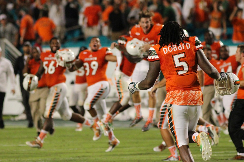 The Canes storm the field after their overtime win against Nebraska. Hallee Meltzer // Photo Editor