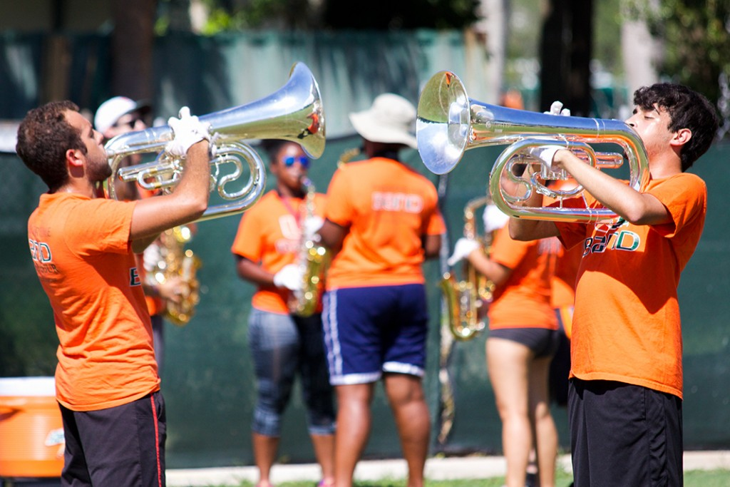 The Band of the Hour rehearses at the IM Fields for Saturday's upcoming game against Bethune-Cookman. Sophie Barros // Contributing Photographer