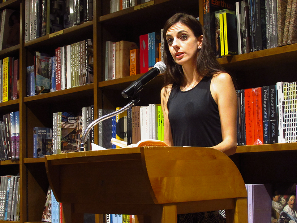 Professor Chantel Acevedo speaks about her writing career at the USpeak Flash Fiction and Poetry Performance at Books & Books. Beatriz Chinea // Contributing Photographer