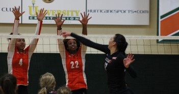 Alexis Mourning (4) and Taylor Scott (22) block a spike from Seattle University on Thursday night. Canes won 3-0. Gian Piero // Contributing Photographer