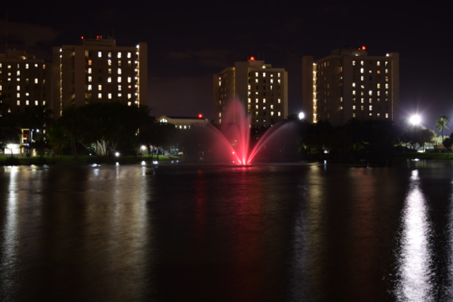 In support of Breast Cancer Awareness, Zeta Tau Alpha sorority lights Lake Osceola's fountain pink Monday evening.  Evelyn Choi // Contributing Photographer