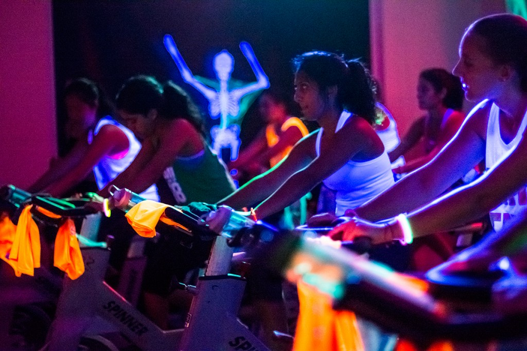 Students bicycle in the Spooky Spin class Monday evening at the Herbert Wellness Center. Attendees were encouraged to come in Halloween costumes. Alisha Kabir // Staff Photographer