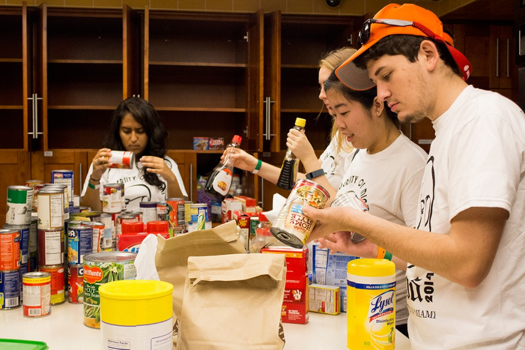 (Left to right) Sophmores Neha Bhaskar, Geena Marzouca, Alyce Kuo, and Aaron Gluck, of the Alpha Phi Omega service fraternity, restock the kitchen and filter out expired food at the Ronald McDonald House Saturday. Shreya Chidarala // Assistant Photo Editor