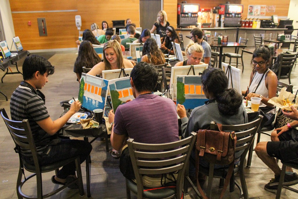 Hurricane Productions hosted Painting and Pitchers at the RAT where students had the opporunity to artistically unwind on their Friday night with the assistance of a professional artist. Kawan Amelung // Staff Photographer