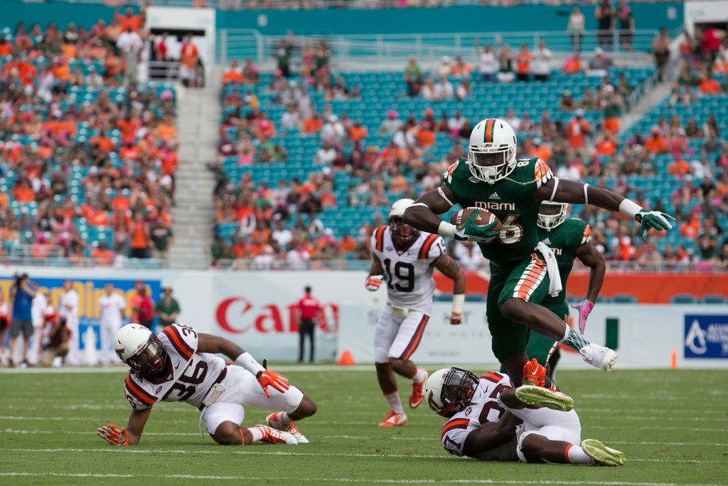 Tight end David Njoku (86) runs over a Virginia Tech defender in the Hurricanes' 30-20 win over the Hoakies last Saturday. Miami takes on Clemson this Saturday at Sun Life Stadium. Matthew Trabold // Staff Photographer