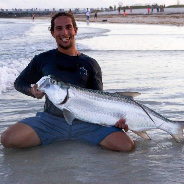 Kevin Rodriguez with a tarpon he caught last year off of South Beach. Photo Courtesy Kevin Rodriguez
