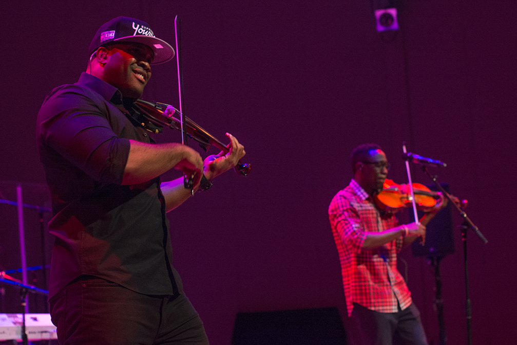 Ken Marcus on violin and Wil B on viola take the stage during Festival Miami's Black Violin concert Sunday afternoon at Gusman Hall. The violin/viola hip-hop duo give classical music a unique twist. Their newest recording, Stereotypes, incorporates a variety of musical influences from classical to R&B, and soul to rock and roll. Not only do they perform on string instruments but they also sing. Throughout their musical career, the duo have performed with Alicia Keys, Kanye West, and Jay-Z. Alisha Kabir // Staff Photographer