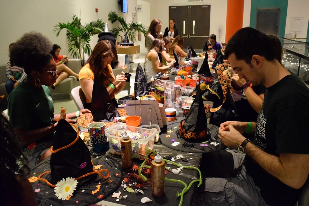During this month's Halloween-themed Canes After Dark, students design their own witch hats Friday evening. Additional entertainment included a fortune teller and henna designer. Evelyn Choi // Contributing Photographer