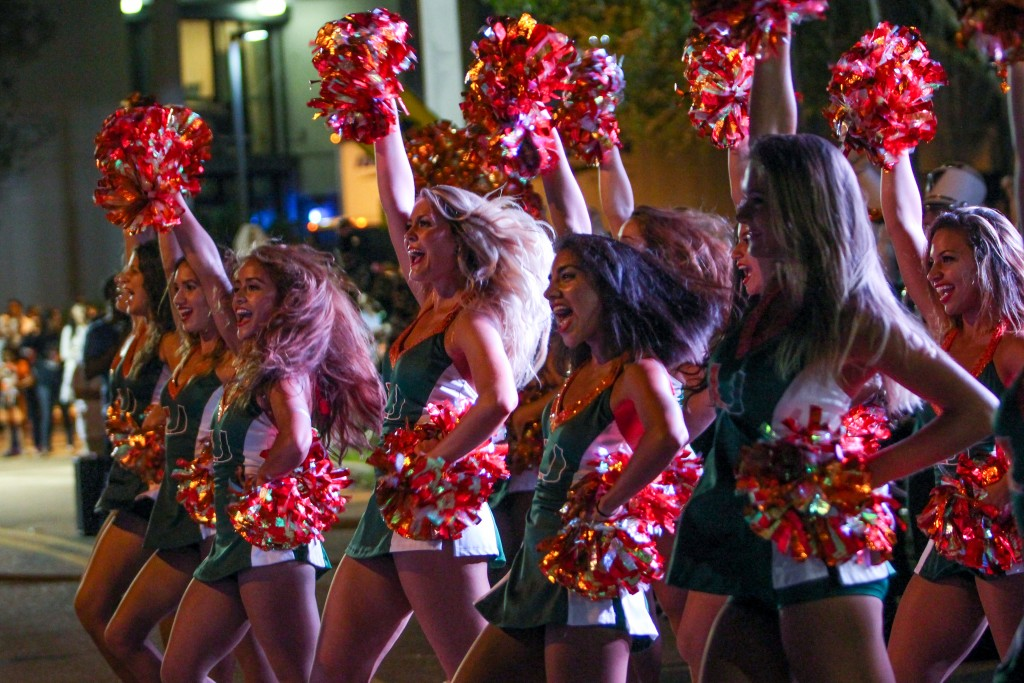 The UM Cheerleaders perform during the Homecoming Parade. Hallee Meltzer // Photo Editor