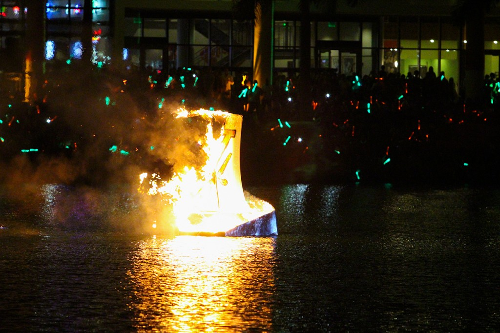 The annual boat burning event on Lake Osceola took place Friday evening during Hurricane Howl. A University of Miami Homecoming tradition, if the mast falls before the boat sinks it is predicted the 'Canes will win the Homecoming football game. Hallee Meltzer // Photo Editor