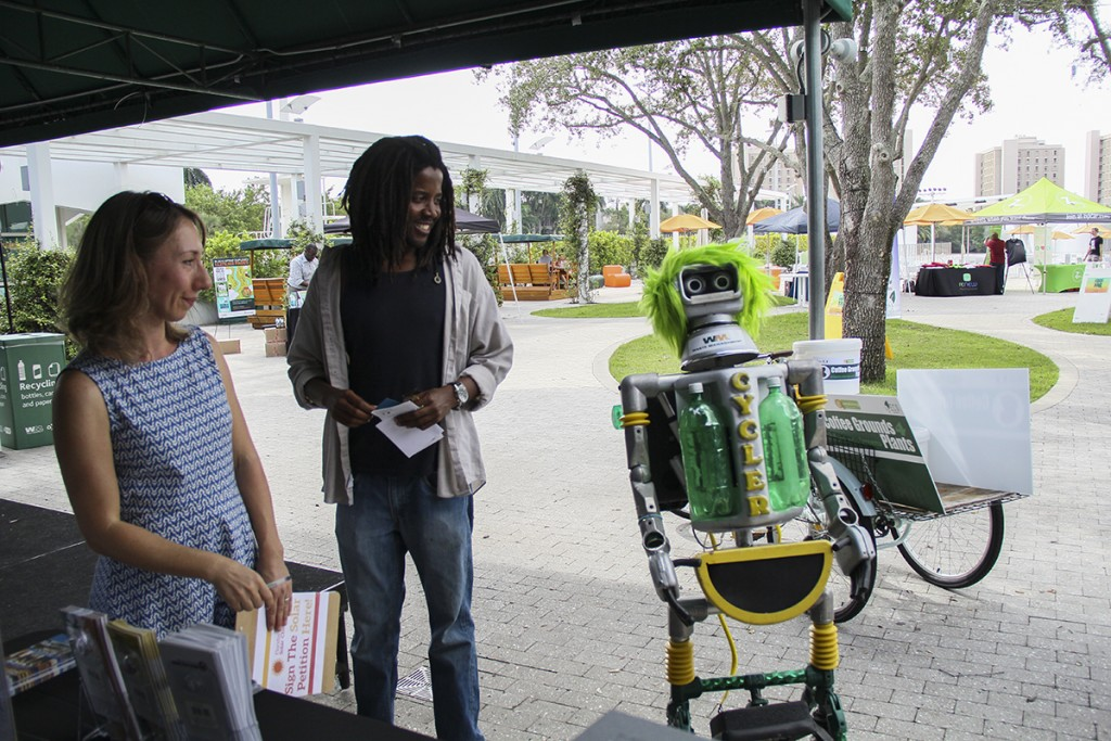 At the Energy and Conservation Organization's annual Green Fair Wednesday afternoon, Cycler, the Waste Management recycling robot, encourages visitors to make sustainable choices. Erum Kidwai // Staff Photographer